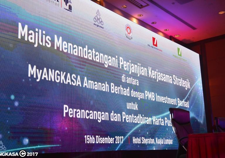 Majlis menandatangani perjanjian kerjasama strategik MyANGKASA Amanah dengan PMBI